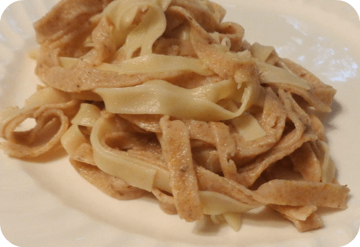 Homemade pasta with white sauce and oregano