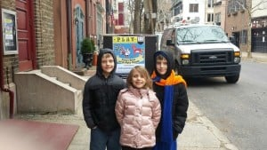 kids with Delaware Mudtub and The Mighty Wampum sign