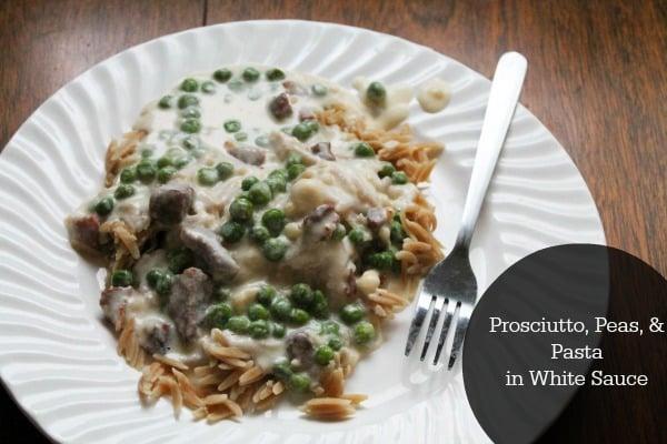 prosciutto, peas, and pasta in white sauce