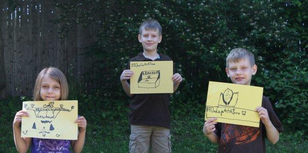 Alexs Lemonade Stand Kids holding signs