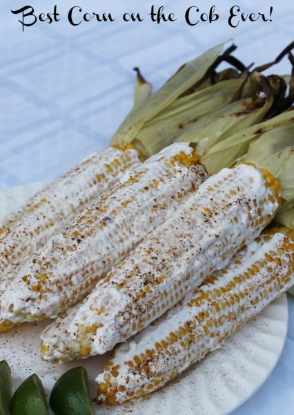 elotes - corn on the cob with sour cream, chili powder, cotija, and lime