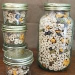 sweet and salty cheerio trail mix in reusable jars