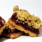 Cranberry Ginger Crumble Bars are a fresh cranberry recipe that will make your mouth water and look pretty on your dessert plate.   www.realthekitchenandbeyond.com