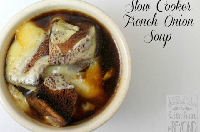 Easy to make at home, Slow Cooker French Onion Soup doesn't have to be reserved for dinner out anymore.| www.realthekitchenandbeyond.com