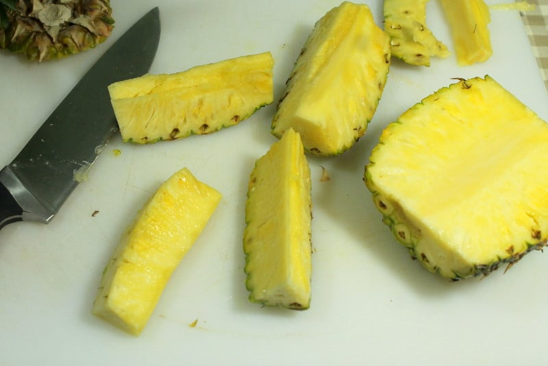 How to cut pineapple easily - cut each quarter in half -