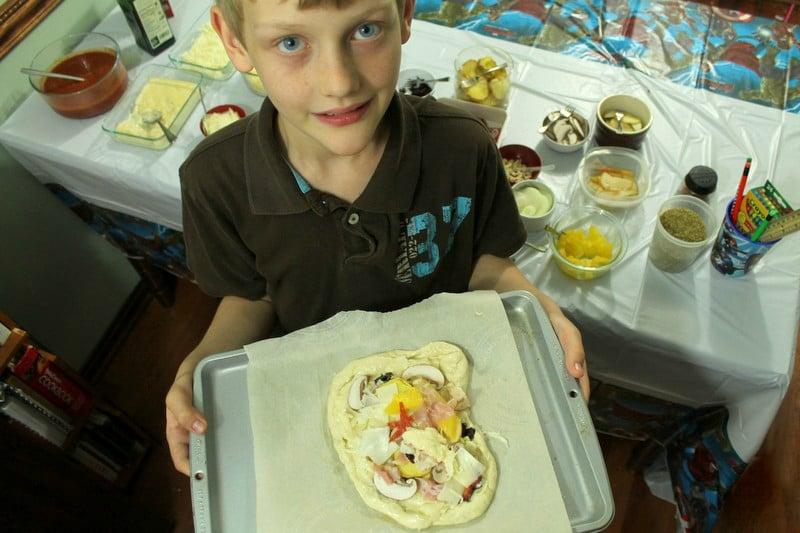 Marvel Avengers Bithday Party Kid Holding Make Your Own Pizza