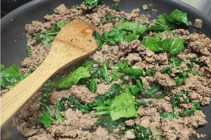 Stuffed Peppers Hamburger Mixture with Fresh Spinach Leaves