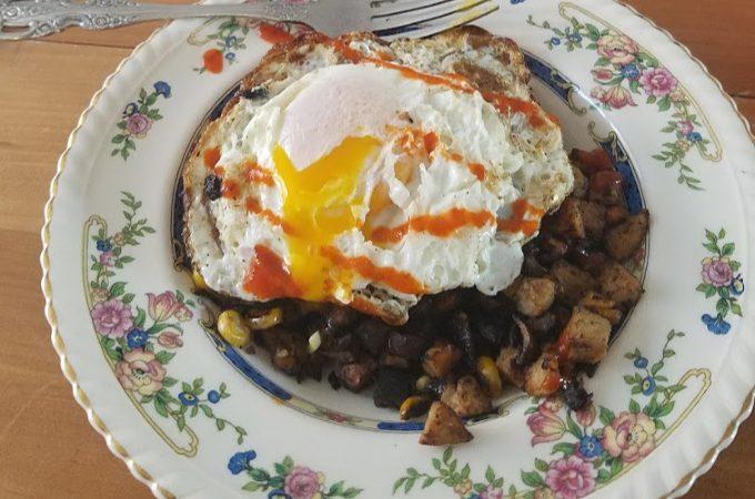 smoked sausage and corn sweet potato breakfast bowl