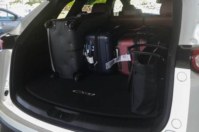 Suitcases in back of sporty Mazda CX-9