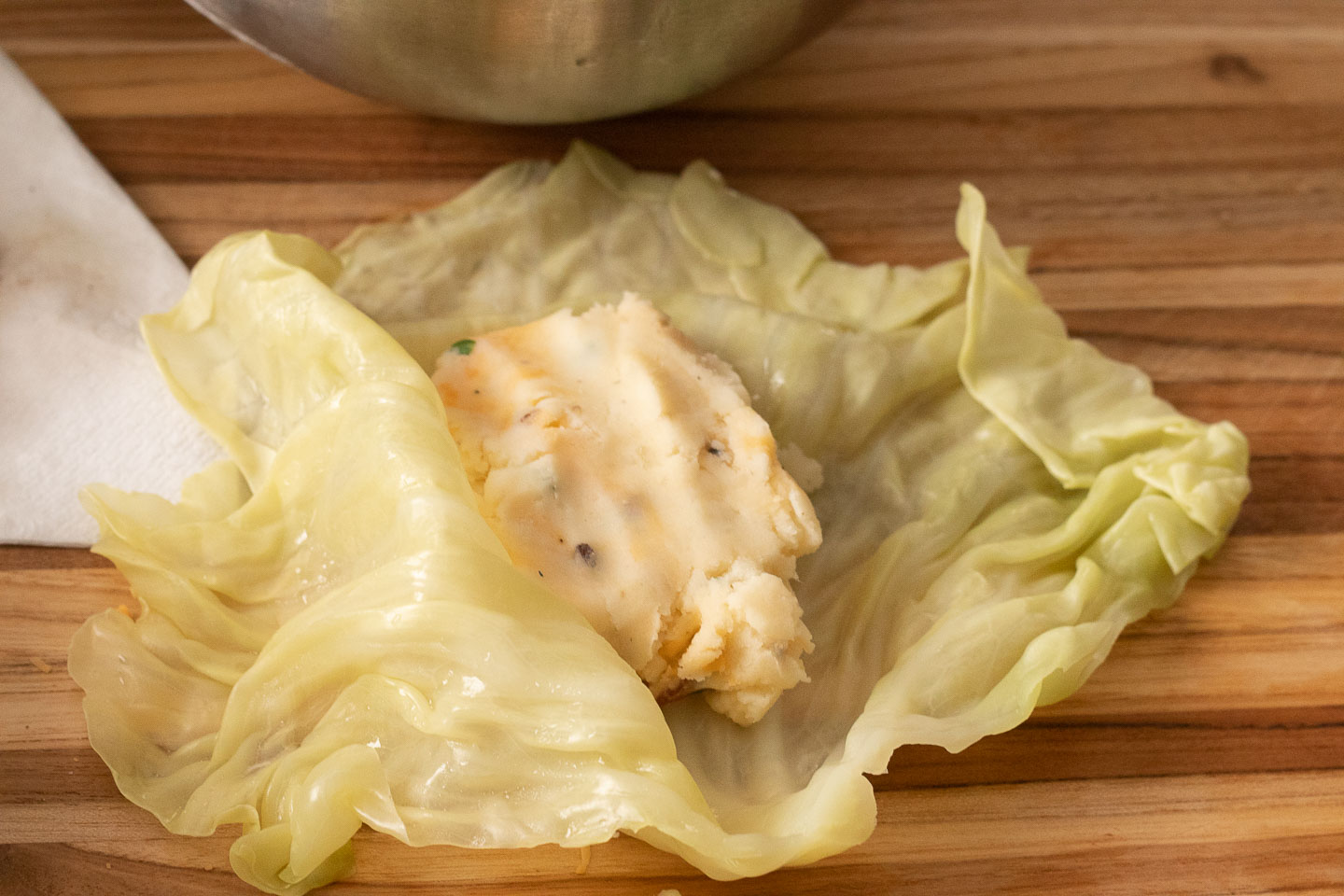 cabbage leaf with loaded mashed potato mixture